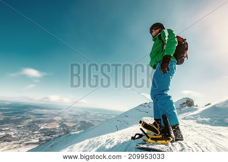 Snowboarder stay on the mountain top .
