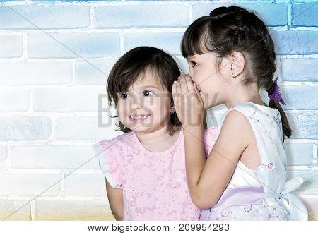 Girls secret gossip gossiping leisure beautiful happy
