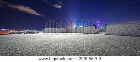 empty asphalt road and cityscape of kuala lumpur at night