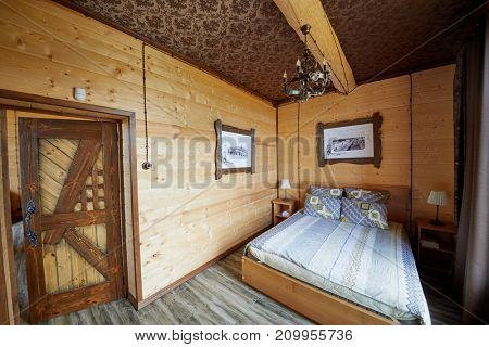 PERESLAVL ZALESSKY, RUSSIA - AUG 28, 2017: Interior of bedroom with double bed in guest house of tourist complex Botik at Plescheevo lake shore, near Museum Botik of Peter the Great.