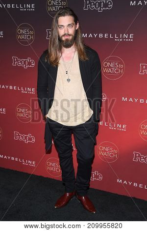 LOS ANGELES - OCT 04:  Tom Payne arrives for the People's 'One's To Watch' Event on October 4, 2017 in Hollywood, CA