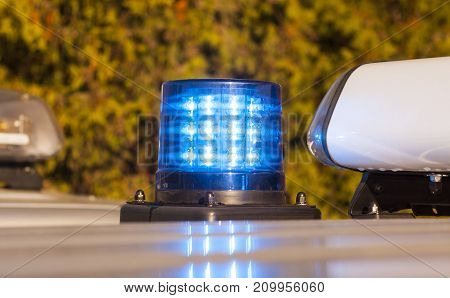 police patrol car of the State Automobile Inspection transport inspection carry public service cloe up view of police roof lights
