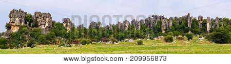 Panomaric view of Naigu Shilin limestone pinnacles Stone forest, Yunnan Province - China. The Stone Forest or Shilin is a UNESCO World Heritage Sites near Kunming