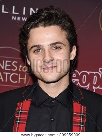 LOS ANGELES - OCT 04:  Dylan Schmid arrives for the People's 'One's To Watch' Event on October 4, 2017 in Hollywood, CA