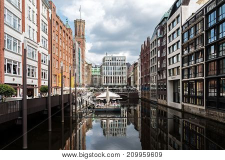 HAMBURG GERMANY - AUGUST 28 2017: café on a pontoon on the fleet the bleichenfleet is a typical water canal in hamburg city between the Elbe River and Binnenalster