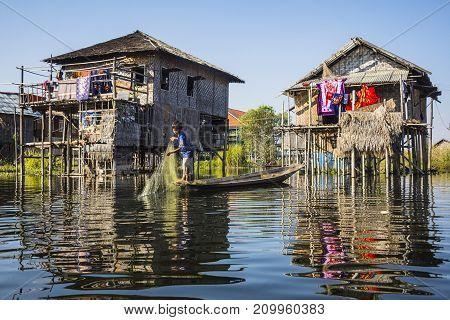 Inle Lake, Myanmar-February 11 2017: Local boy fishing in a traditional village named Nampan located in Inle lake,Myanmar.