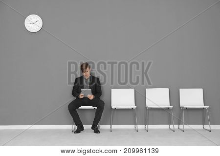 Young man waiting for job interview in hall