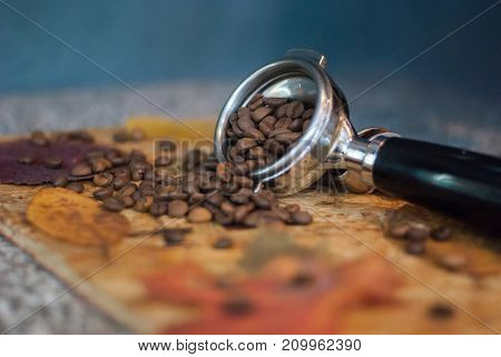 Holder of coffee maker and scattered coffee beans