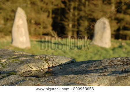 Standing stones viewed from the top of recumbent stone in stone circle, Aikey Brae, Scotland