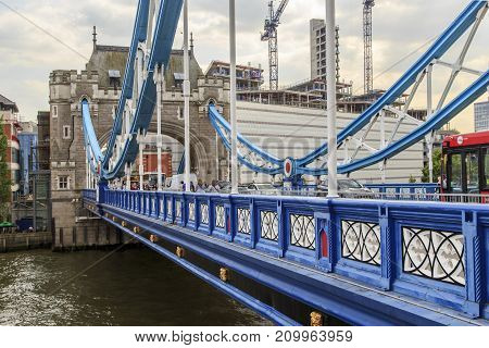 LONDON, GREAT BRITAIN - MAY 16, 2014: This is a fragment of the divergent spans of the Tower Bridge.
