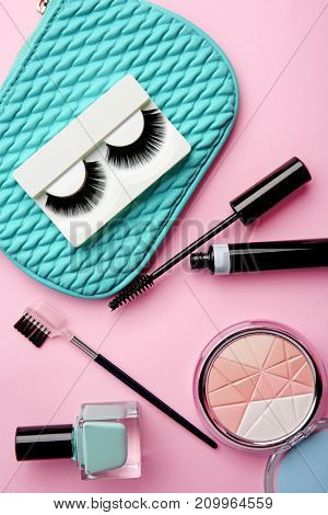 Set for makeup with false eyelashes on color background