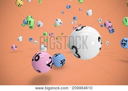 Falling lottery balls  against orange background