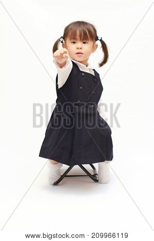 Japanese Girl On The Chair Playing Rock-paper-scissor In Formal Wear (2 Years Old) (rock)
