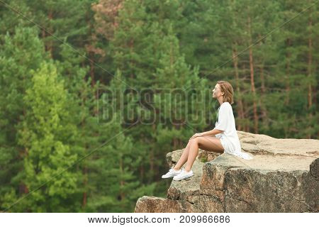 Young beautiful woman spending time outdoors