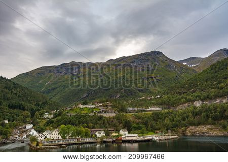 Hellesylt is a small village in Stranda Municipality Norway. The village lies at the head of the Sunnylvsfjorden which is a branch of the Storfjorden and which the more famous Geirangerfjorden in turn branches off nearby.