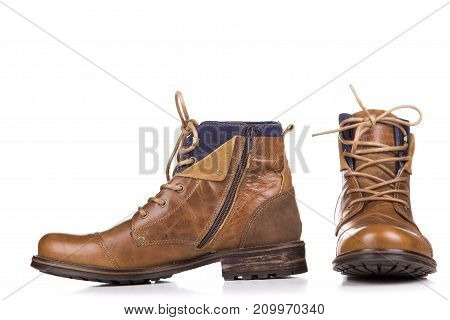 A Pair Of Worn Boots Isolated On A White Background