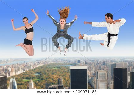 Man and women jumping over white background against new york