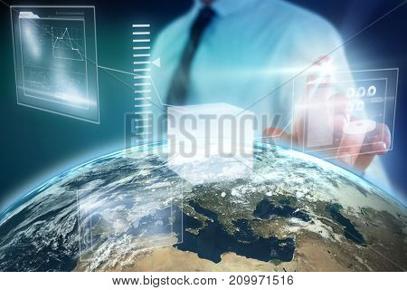 Midsection of businessman using futuristic digital screen against blue background with vignette