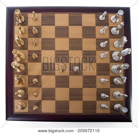 Chess set viewed from above with silver and gold pieces