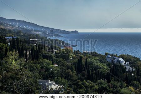 A view from above of the city, sea and mountains during a storm. Russia, the Crimea, Yalta and Alupka.