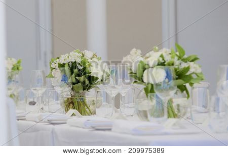 A wedding day table setting all in white