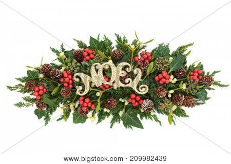 Christmas decoration with gold noel sign, holly, ivy, mistletoe, fir and pine cones on white background.