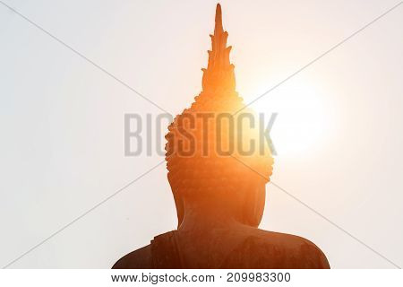 Head of buddha statue under the sun shines in Thailand temple