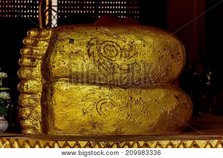 Detail view of Buddha's feet in the Temple at sakonnakhon province thailand.