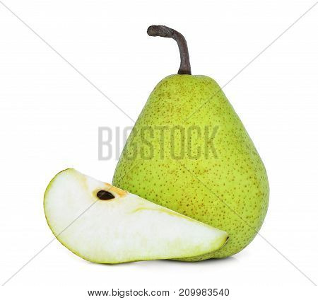 whole and slice of green packham pear isolated on white background