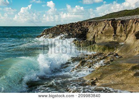 Waves crashing on shore at Blowing Rocks Preserve beach in Hobe Sound Florida