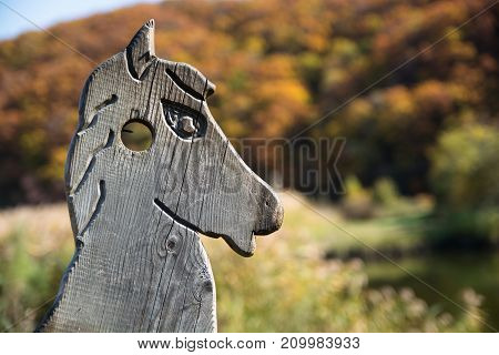 Wooden horse head - handmade decoration. Old wooden carved horse head.