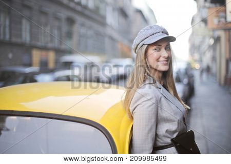 Smiling blonde girl in the street