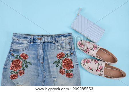 Embroidered flowers skirt , shoes, handbag – blue background
