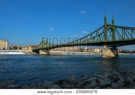 Liberty Bridge in Budapest, Hungary. Danube River.