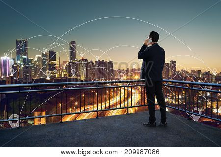 Businessman using phone on open terrace modern city with internet connect with hotspot in downtown concept background .
