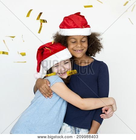 two girls celebrating a Christmas time