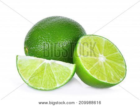 fresh green lime with half and slice isolated on white background