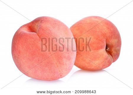 two whole of peach isolated on the white background