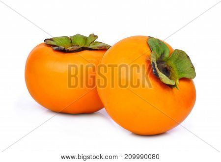 two whole of fresh ripe persimmons isolated on white background