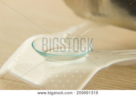 Contact lenses for the eyes close-up on the package on a wooden table