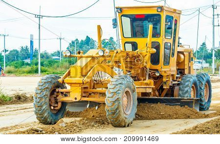 Road grader - heavy earth moving road construction equipment