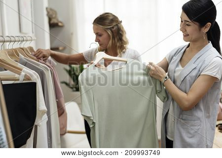 People checking out clothes
