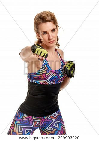 Athletic powerful woman prepare to fight and giving punch