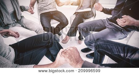 Group therapy in session sitting on chairs