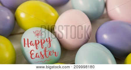 Easter illustration against multicolored easter eggs on wooden surface