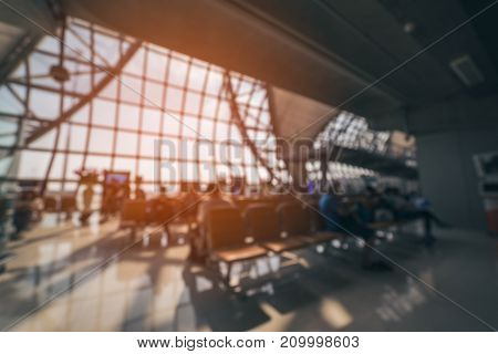 Blurred abstract background waiting room people sitting on chairs zone in airport or bus stationuse as background.