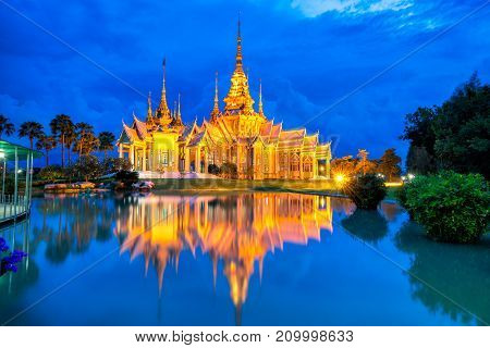 Beautiful sunset scene of thai temple at Wat None Kum or Wat Non Kum at Nakhon Ratchasima province Thailand. It's popular thai temple in Thailand.