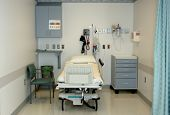 a real hospital bay where patients are prepared before surgery; vitals,paperwork,meds. (12mp camera, focus=bed) poster