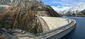 Koelnbrein Dam and the dam reservoir in the Hohe Tauern range within federal state of Carinthia, Austria. poster