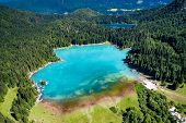 Lake Lago di Fusine Superiore Italy Alps. Aerial FPV drone flights. poster